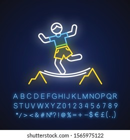 Highlining neon light icon. Slacklining. Walking and balancing on tightrope. Slackliner in mountains. Extreme sport stunt. Walker on rope. Glowing alphabet, numbers. Vector isolated illustration
