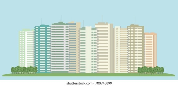 High-rise buildings of the city and a green field.