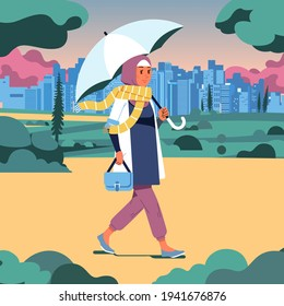 hijab woman walking in the park holding an umbrella on a cloudy day, park and cityline as background. used for landing page image and other