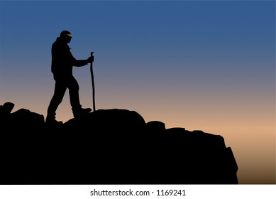 Hiker silhouetted at mountain summit