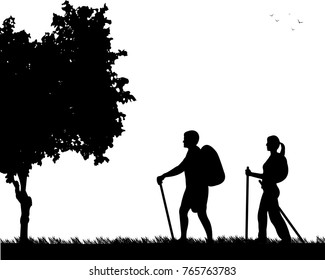 Hiking couple with rucksacks in park silhouette, one in the series of similar images