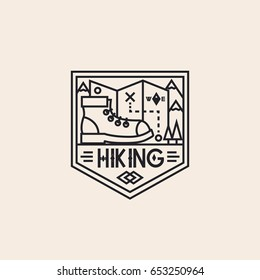 Hiking logo consisting of boot, maps and landscape line style isolated on background for explore emblem, camping logotype, hiking sticker, tourist symbol, travel badge, expedition label, poster