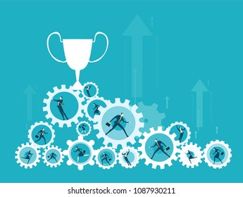 Hip of cogs with office workers in it and trophy on top of it.