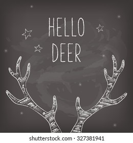Hipster Christmas card with chalk deer antlers, chalkboard