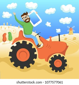 The hipster on the tractor with a tablet