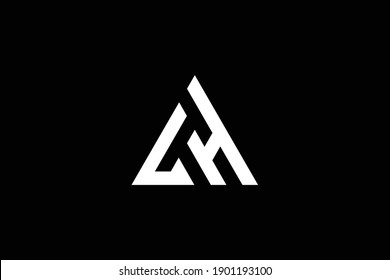 HL letter logo design on luxury background. LH monogram initials letter logo concept. HL icon design. LH elegant and Professional white color letter icon on black background.