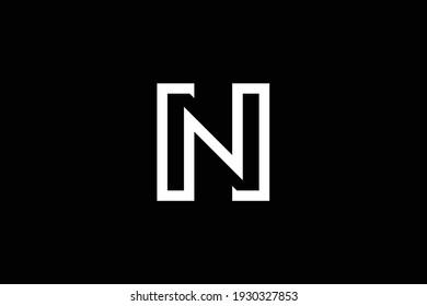 HN letter logo design on luxury background. NH monogram initials letter logo concept. HN icon design. NH elegant and Professional white color letter icon design on black background.