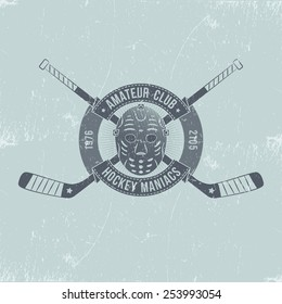 Hockey club logo with crossed sticks, goalie mask, and a circular ribbon - in old school style with grungy scratches. Texture on a separate layer and can be easily removed.