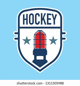 A hockey crest design with an ice hockey goal light icon in the middle.