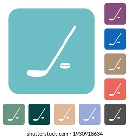 Hockey stick and puck white flat icons on color rounded square backgrounds