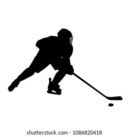 Hockey striker owns the puck silhouette