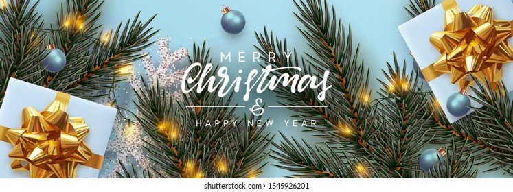 Holiday background Merry Christmas and Happy New Year. Xmas design with realistic festive objects, Pine and spruce branches, sparkling lights garland, gift box, silver snowflake, balls bauble.