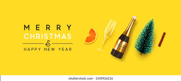 Holiday background Merry Christmas and Happy New Year. Xmas design with realistic festive objects, bottle champagne wine with glass, decorative pine tree, cinnamon and orange slice. Christmas spruce