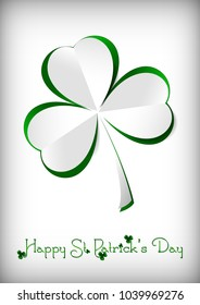 Holiday card on St. Patrick's Day in March 17. Paper clover on white background. Vector illustration