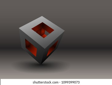 Hollow cube with orange interior.A hollow cube balanced on a corner with a colorful orange interior against a dark background.