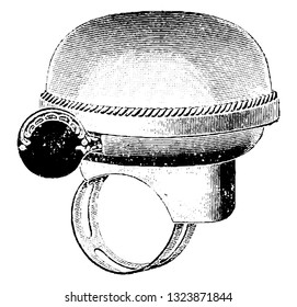 It is a hollow metal object, typically in the shape of a deep inverted cup widening at the lip, it produces sound when struck. It is attached near the handle bar. Bicycle Accessories 1900.