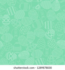 Holy Easter seamless background. Painted eggs with ornaments on a light green spring background. Vector illustration.