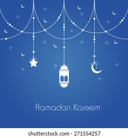 Holy month of muslim community, Ramadan Kareem celebration greeting card with hanging arabic lamp, star and moon on blue background.