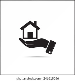 Home on the hand vector icon