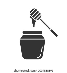 Honey jar with dipper glyph icon. Silhouette symbol. Negative space. Vector isolated illustration