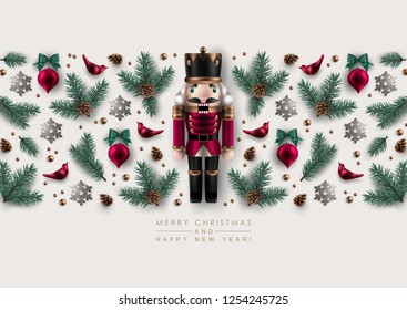 Horizontal Christmas Border made of Nutcracker, Realistic Pine Branches, Glass Christmas Ornaments and Glitter Snowflakes. Flat lay, top view.