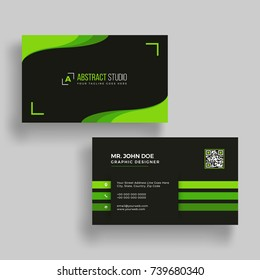 Horizontal green and black business card with front and back presentation.