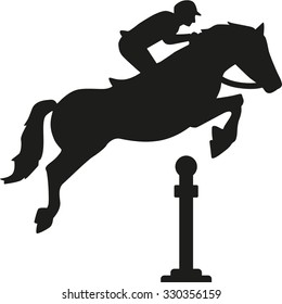 Horse jumping over obstacles
