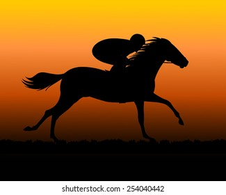 Horse rider silhouette with sunset background
