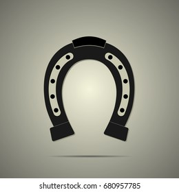 Horseshoe icon in flat style with shadow, black and white colors