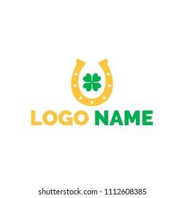Horseshoe logo with four-leaf clover