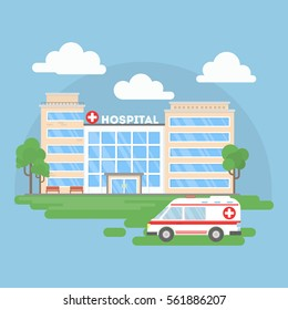 Hospital building with ambulance. Urban background. Modern medical center with first aid.