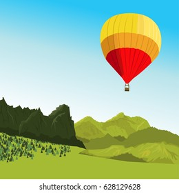 Hot air balloon flying above the mountains in summer