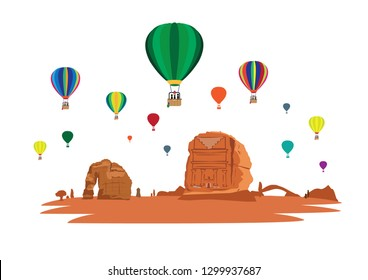 Hot Air Balloons Fly Over the Rock formations, Qasir Al Farid in Madain Saleh and Elephant Rock located in the desert of Saudi Arabia's Al Ula county