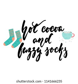 Hot cocoa and fuzzy socks - hand drawn cozy Autumn and Winter lettering and Hugge doodles with cup, marshmallow and warm socks isolated white background. Fun ink vector illustration for cards design