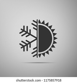 Hot and cold symbol. Sun and snowflake icon isolated on grey background. Winter and summer symbol. Flat design. Vector Illustration