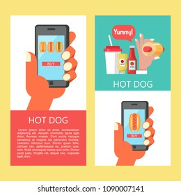 Hot dog. Sausage in a bun with mustard. The hand holds a smartphone. Hot fast food.  Order hot dogs through the app on your smartphone. Hot dog in hand, standing next to a bottle of mustard and ketchu