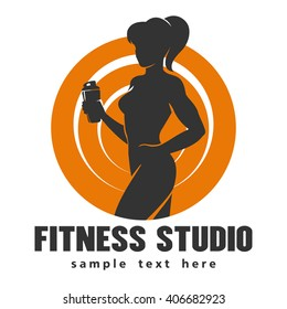 Hot sexy athletic girl bodybuilder holds shaker and sample text below over white background.Emblem of fitness or gym center