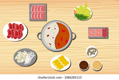 Hotpot and ingredients on the wooden table