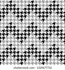 Houndstooth plaid pattern vector. Zig zag / chevron stripes. Classic fashion pattern in black, white, and grey for textile design.