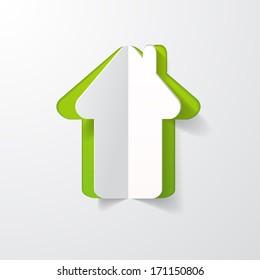 a house cut in paper
