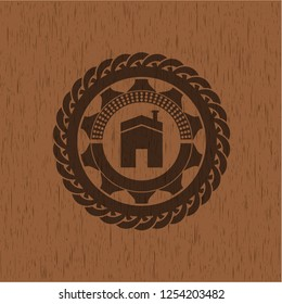 house icon inside badge with wooden background