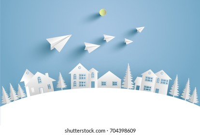a house on a snow hill and there are paper planes on it with paper and craft art designs