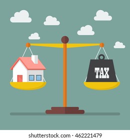 House and Tax balance on the scale. Business Concept