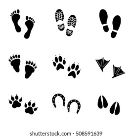 Human and animal footprints icon set on white background. Vector art.