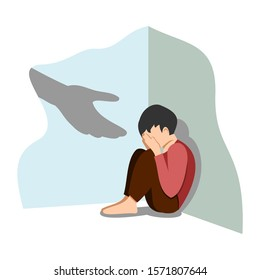 The human hand helps a lonely boy to recover from depression. The concept of support and care for people who are stressed. Depressed little children sit alone.