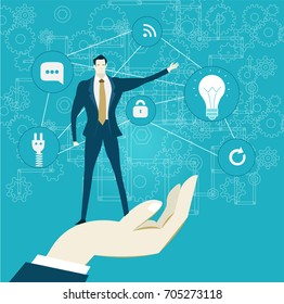 Human hand holding businessmen in front of the communication and business icons. Concept illustration