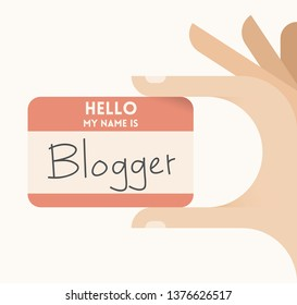 Human hand holding card with text Hello, I am Blogger. Concepts: online blogging, social media services, internet relationships, social networking, journalism and news.
