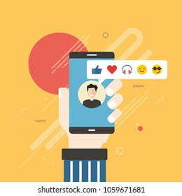 Human hand holding mobile phone with social network feedback emoticons : thumbs up, like, smile, earphone, face sunglasses on screen. Concept of facial expression, text messaging and using phone.