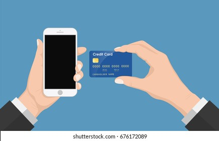 Human hand holding phone with credit card , isolated on blue background