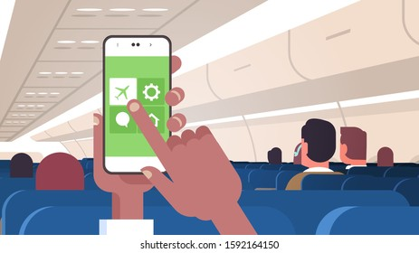 human hand holding smartphone with flight mode rules of airplane safety concept modern plane board with passengers horizontal flat vector illustration